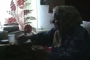 This is an example of a woman's prayer. Baba Liuba holds the patient's hands during the prayer.