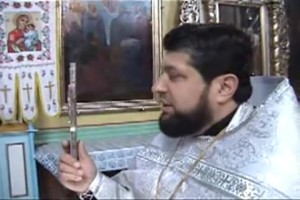The priest gives his blessing to everybody and calls them forth to kiss the cross.