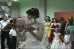 The bride picks one of the bouquets from those given by guests, not the bridal bouquet, and throws it into the crowd.