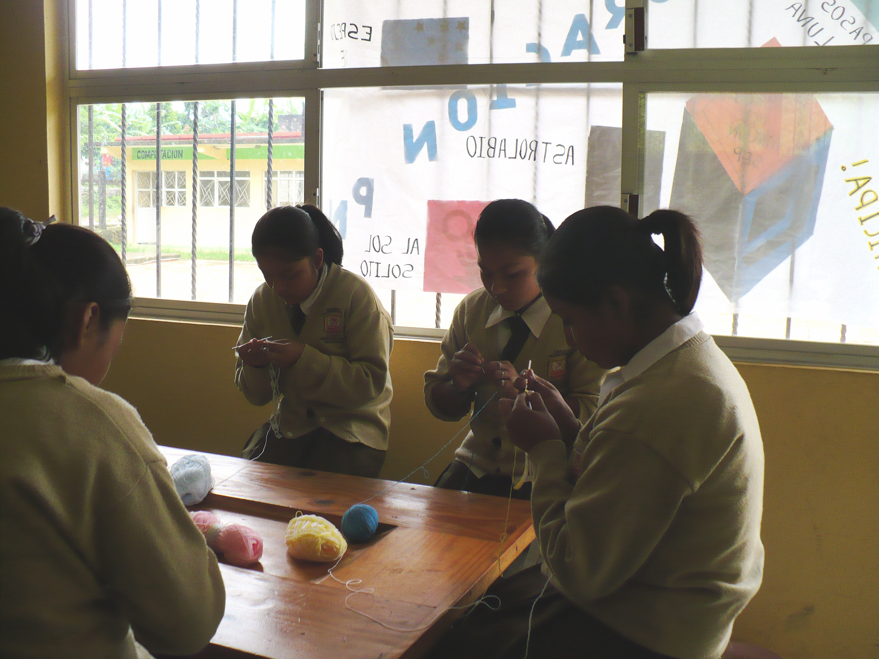 Secondary school girls learn to crochet, weave, and do needle point.