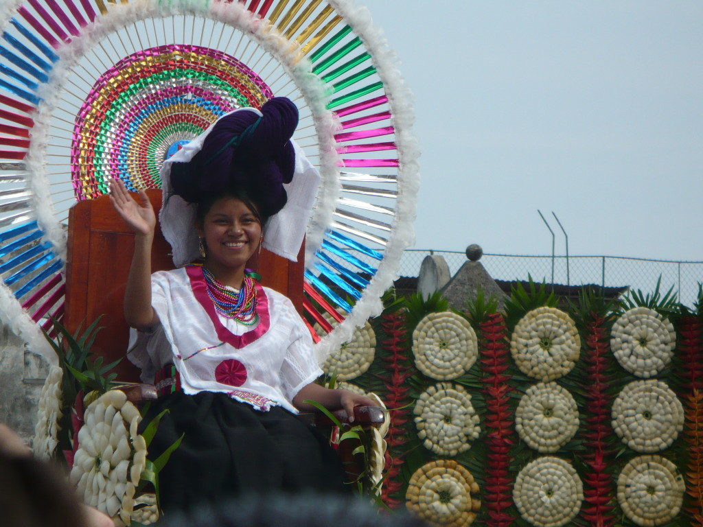 The queen of the feria waves to the crowd in Cuetzalan.