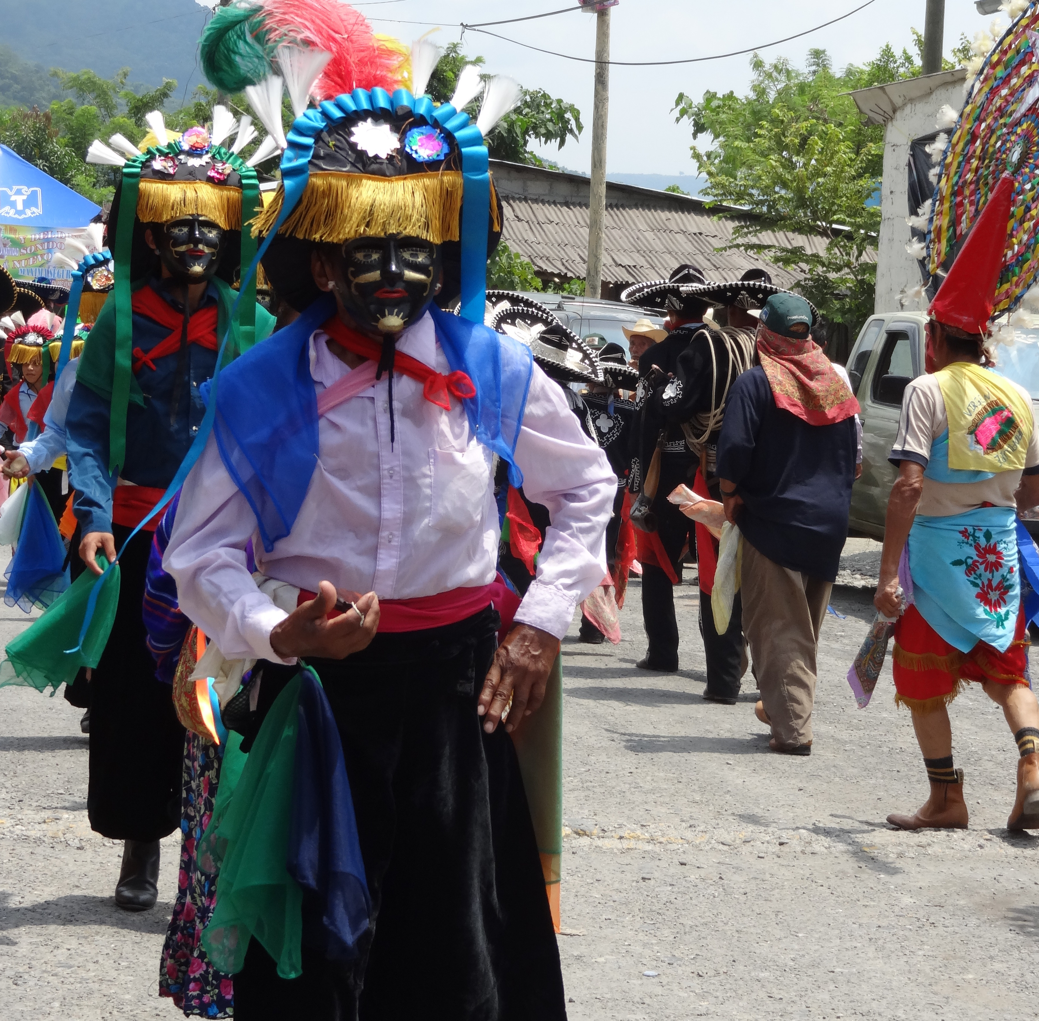 Totonacs performing La danza de los negrito  dressed in costumes influenced by colonial dress, and dancers with a snake motif around the waist. Patla festival, 2012